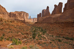 Park Avenue. Well known landmark Park Avenue in Arches National Park with hikers on trail Stock Image