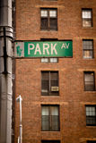 Park Avenue street sign. Green Park Avenue street sign with a brick building in the background Stock Images