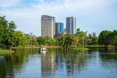 Park in Bangkok city with modern business building Royalty Free Stock Image