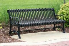 Park Bench. Wrought iron park bench royalty free stock photos