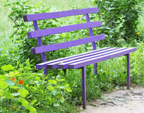 Park bench. An inviting garden bench to rest on Stock Image