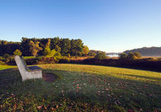 Park Bench. With a crystal blue sky and autumn colors Stock Photos