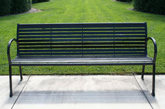 Park Bench. Inviting park bench in serene park setting Stock Images