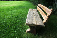 Park Bench. Wooden bench in the park on a summer afternoon stock photography