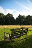 Park Bench. Open parkland view from an empty park bench Stock Images