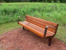 Park Bench. Wooden and metal bench in Fish Creek Park, Calgary, Alberta, Canada Stock Photos