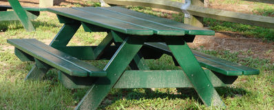 Park Bench. A closeup of a common park bench, painted in green royalty free stock photography