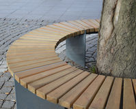 Park Bench. A park bench built round a tree royalty free stock image