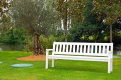 Park Bench. White Park Bench in a field of grass Stock Photos
