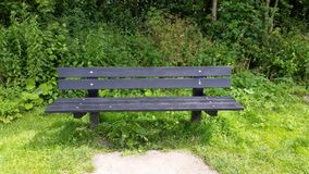 Park Bench. A bench in the park Stock Photo