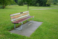 Park Bench. An empty park bench in green park Stock Images
