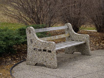 Park Bench. And resting area along a walking path Royalty Free Stock Photos