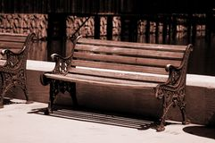 Park Bench. Next to water Royalty Free Stock Photography