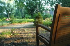 The park bench. A bench facing a beautiful wooded park in germany Royalty Free Stock Photo