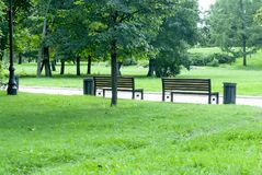 Park Bench and Alley in park outdoors Stock Photo