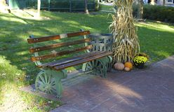 Park Bench with Autumn Decorations Stock Image