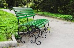 Park bench. Bench in the Botanical garden of Kaliningrad Royalty Free Stock Photo