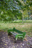 Park bench. A broken bench in the Park Stock Image