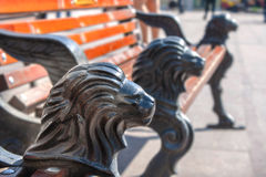 Park bench with cast iron legs in the form of a lion's head Stock Image