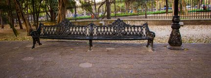 Park bench in chapultepec park royalty free stock photography