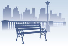 Park bench on the city background Royalty Free Stock Image