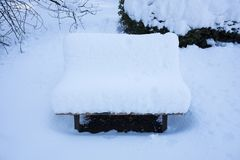 Park bench covered with snow. At a park of Tokyo, Japan Stock Image