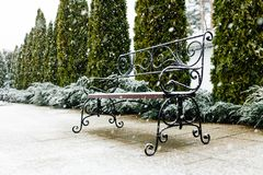 A Park bench covered with snow. Snow, beautiful snow, nice weather. Place for text Royalty Free Stock Images