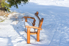 Park bench covered with snow on a winter day Royalty Free Stock Photos
