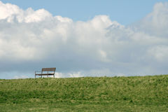 Park bench on the dike Stock Photos