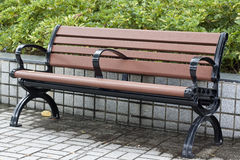 Park Bench. An empty Park Bench in the park on a sunny day Stock Photos