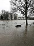 Park bench in the flooded River Ouse in York, England Royalty Free Stock Photography