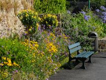 Park bench and flowers in Dinard, Brittany France. Park bench and flowers in Dinard in summer, Brittany France Stock Photo