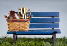 Park bench and football . Stock Photography