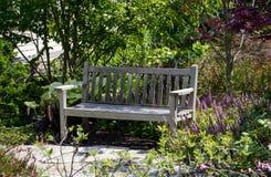 Park bench in a garden Royalty Free Stock Photos