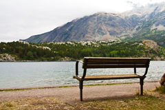 Park Bench at the Lake. An empty bench at a mountain lake Stock Images