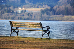 Park bench at lake Stock Photo