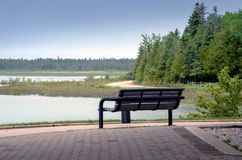 Park bench on lake huron Royalty Free Stock Images
