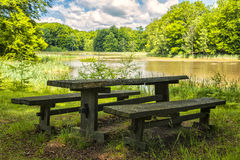 Park bench by lake Stock Images
