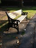 Park Bench. Casting shadow Royalty Free Stock Images