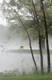 Park bench in the mist Stock Photo