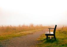 Park bench in morning fog. Park bench in morning haze in sunrise Stock Photo