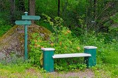Park bench in Mustila Arboretum Stock Photography