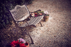 Park Bench. Old bench surrounded by flowers. Florence, Tuscany Stock Photo