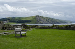 Park Bench Overlooking Coastal Bay Stock Images