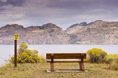 Park bench overlooking lake Royalty Free Stock Images