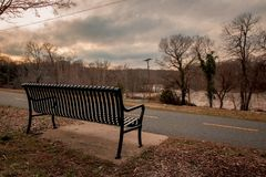 Park bench overlooking Rappahanock River royalty free stock images