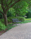 Park  Bench and Pavestone Walkway Stock Image