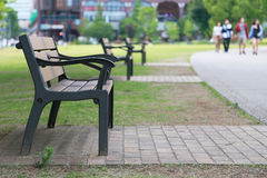Park bench and pedestrian. Park bench and sidewalk pedestrians Royalty Free Stock Photos
