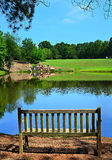 Park Bench on a Pond Royalty Free Stock Photos