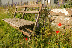 Park bench with poppys Stock Photo